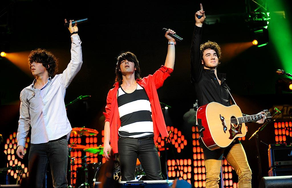 """The Jonas Brothers barely have time to sleep these days. In between gigs as the opening act for Miley Cyrus, the boys delivered a rousing set for their adoring fans. Kevin Mazur/<a href=""""http://www.wireimage.com"""" target=""""new"""">WireImage.com</a> - December 14, 2007"""