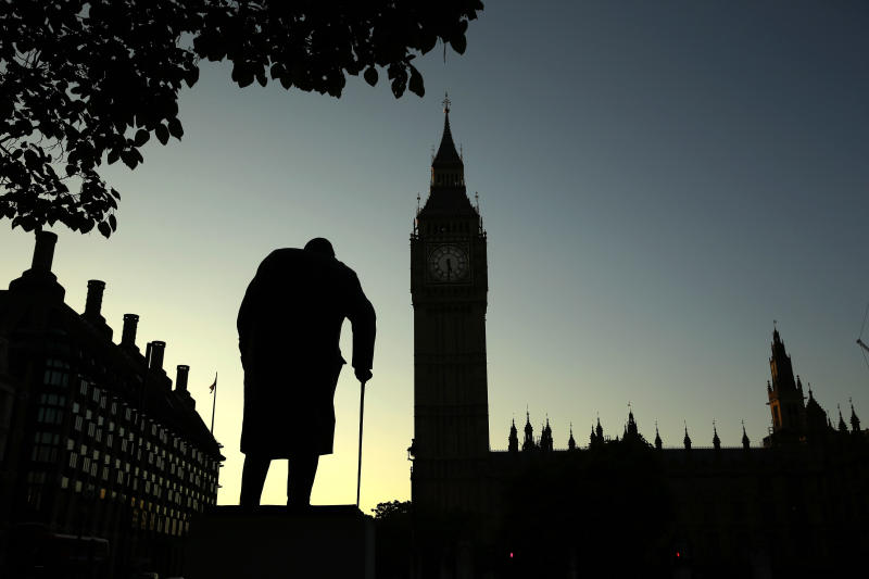 FILE - In this Friday, June 24, 2016 file photo a statue of Winston Churchill is silhouetted against the Houses of Parliament and the early morning sky in London, Friday, June 24, 2016. A day earlier, Britain had voted to leave the European Union in a referendum. On Jan. 31, 2020, Britain is scheduled to leave the EU after 47 years of membership. (AP Photo/Matt Dunham, File)