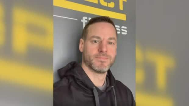 Justin Peter Bodnarchuk, 39, was arrested Monday after social media posts expressed contempt toward women, feminists and police, the Winnipeg Police Service said. One post also included a threat to kill a specific person, according to police. (Aspect Fitness/Instagram - image credit)