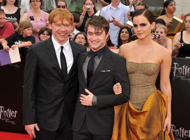 """(L-R) Rupert Grint, Daniel Radcliffe and Emma Watson at the New York premiere of """"Harry Potter And The Deathly Hallows: Part 2"""" on July 11, 2011"""