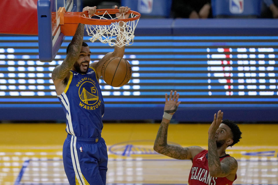 Golden State Warriors guard Mychal Mulder (15) dunks in front of New Orleans Pelicans guard Nickeil Alexander-Walker, right, during the first half of an NBA basketball game on Friday, May 14, 2021, in San Francisco. (AP Photo/Tony Avelar)