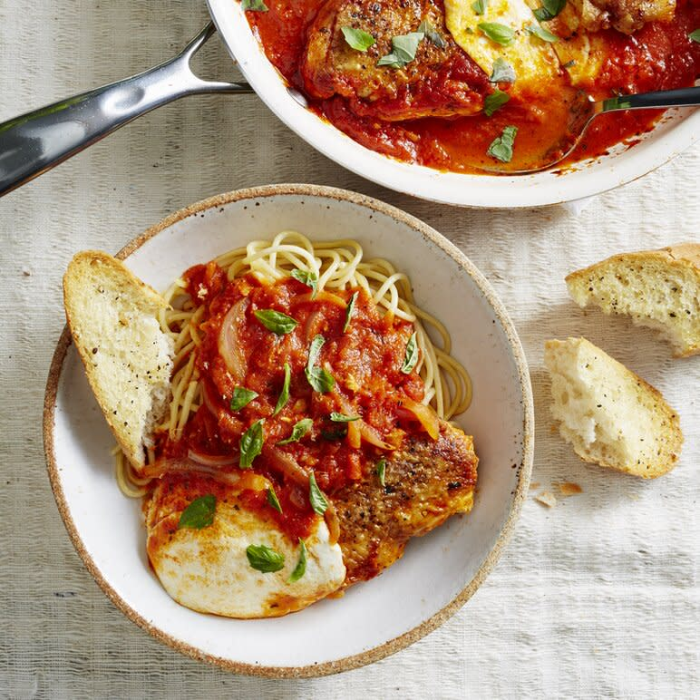 "<p>Building incredible flavor in a single skillet is one of the smart tricks pro cooks use to get food on the table fast. That said, you'll actually need 2 skillets—a 12-inch nonstick for cooking and a 10-inch cast-iron for weight—to make this fabulous chicken-under-a-brick inspired dinner. The heavy cast-iron acts as your ""brick,"" which is essential to getting glorious crispy skin and helps speed up the cooking. You could also use a large brick or tile wrapped in aluminum foil for the same effect. The result is super juicy chicken, with ridiculously crisp skin, ready in a fraction of the time it would typically take to cook whole chicken breasts on the stovetop. And once you throw marinara saucy and melty mozzarella into the mix… well, you've got a weeknight recipe the family is going to beg for again and again. Serve the completed saucy-cheesy chicken over pasta or on toasted hoagie rolls. </p> <p><a href=""https://www.myrecipes.com/recipe/single-skillet-crispy-chicken-caprese-dinner"">Single-Skillet Crispy Chicken Caprese Dinner Recipe</a></p>"