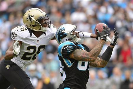 Dec 22, 2013; Charlotte, NC, USA; Carolina Panthers wide receiver Steve Smith (89) catches the ball as New Orleans Saints cornerback Keenan Lewis (28) defends in the first quarter at Bank of America Stadium. Bob Donnan-USA TODAY Sports