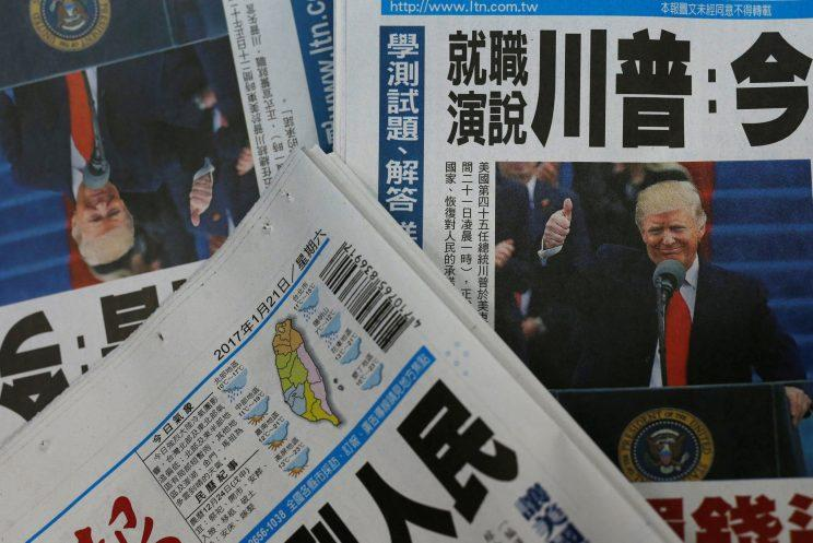 Copies of Taiwanese daily newspaper Liberty Times, with its frontpage on the inauguration of President Trump. (Photo: Tyrone Siu/Reuters)