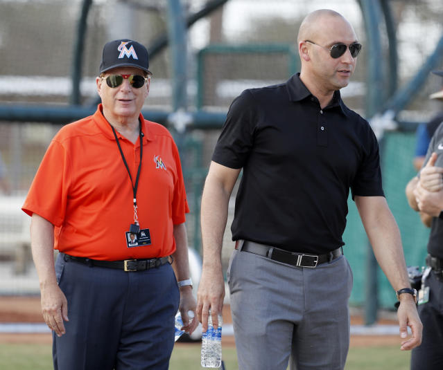 Miami Marlins chief executive officer Derek Jeter, right, walks with Marlins majority owner Bruce Sherman during spring training baseball practice Monday, Feb. 19, 2018, in Jupiter, Fla. (AP Photo/Jeff Roberson)