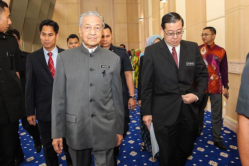 Tun Dr Mahathir Mohamad and Lim Guan Eng (right) arrive at the National Finance Council Meeting in Putrajaya June 7, 2018. ― Picture by Miera Zulyana