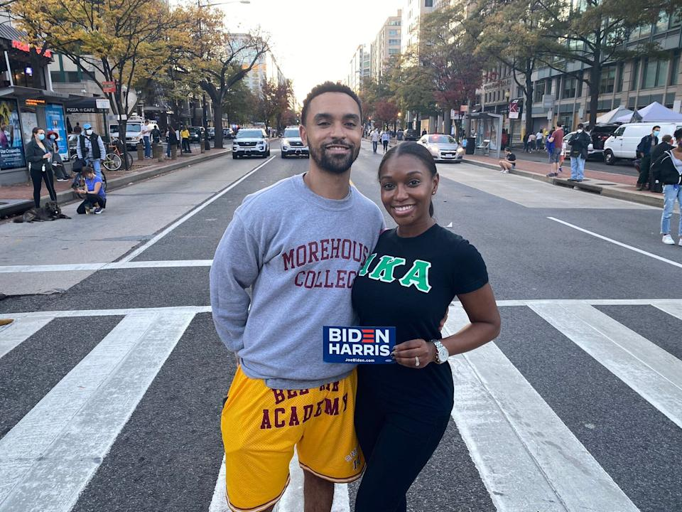 Theo Guidry and his wife, Gina, came to Black Lives Matter Plaza wearing a Morehouse College sweater and Alpha Kappa Alpha shirt. (Photo: Philip Lewis/HuffPost)