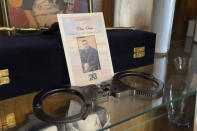 This July 15, 2021 image shows handcuffs that belonged to Elias Otero in a memorial hutch at his family's home in Albuquerque, New Mexico. Otero, 24, had served nearly four years as a corrections officer before switching careers. He was shot to death outside his home in February. No arrests have been made. Homicide rates in many American cities have continued to rise although not as precipitously as the double-digit jumps seen in 2020 and still below the violence of the mid-90s. (AP Photo/Susan Montoya Bryan)