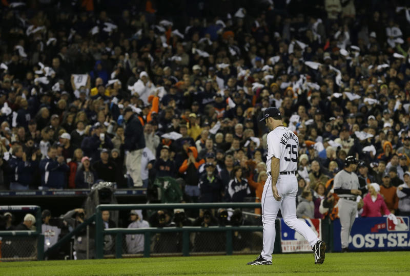 Fans applaud as Detroit Tigers' Justin Verlander is taken out of the game in the ninth inning during Game 3 of the American League championship series Tuesday, Oct. 16, 2012, in Detroit. (AP Photo/Paul Sancya )