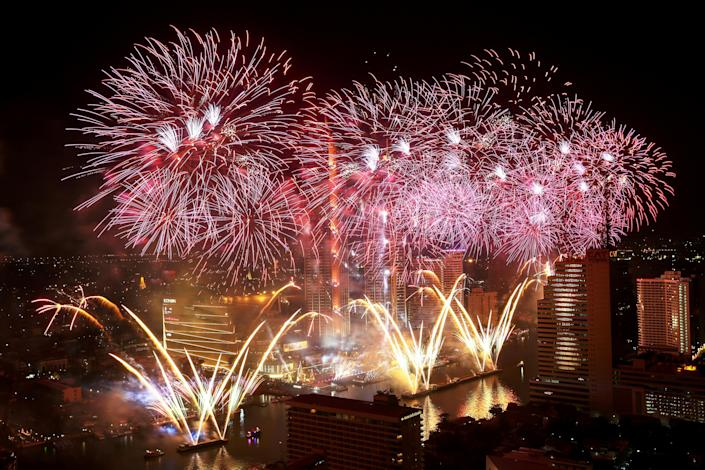 Fireworks explode over Chao Phraya River. (Photo: Athit Perawongmeth/Reuters)