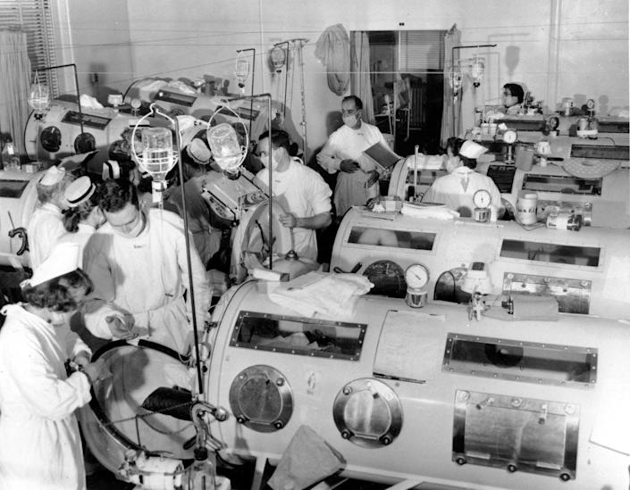 """<span class=""""caption"""">An emergency polio ward in Boston in 1955 equipped with iron lungs. These pressurized respirators acted as breathing muscles for polio victims, often children, who were paralyzed.</span> <span class=""""attribution""""><a class=""""link rapid-noclick-resp"""" href=""""http://www.apimages.com/metadata/Index/Associated-Press-Domestic-News-Massachusetts-Un-/ade0290b02e5da11af9f0014c2589dfb/15/0"""" rel=""""nofollow noopener"""" target=""""_blank"""" data-ylk=""""slk:www.apimages.com"""">www.apimages.com</a></span>"""