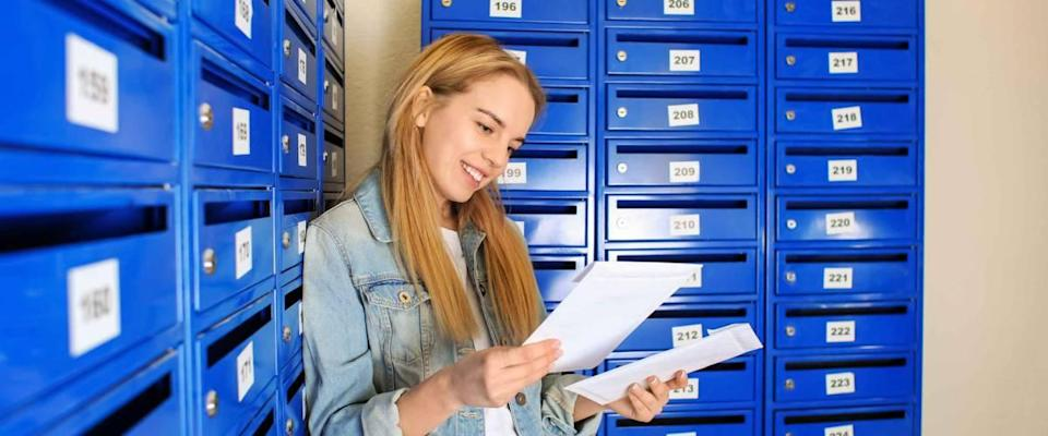 Young woman checking her mail