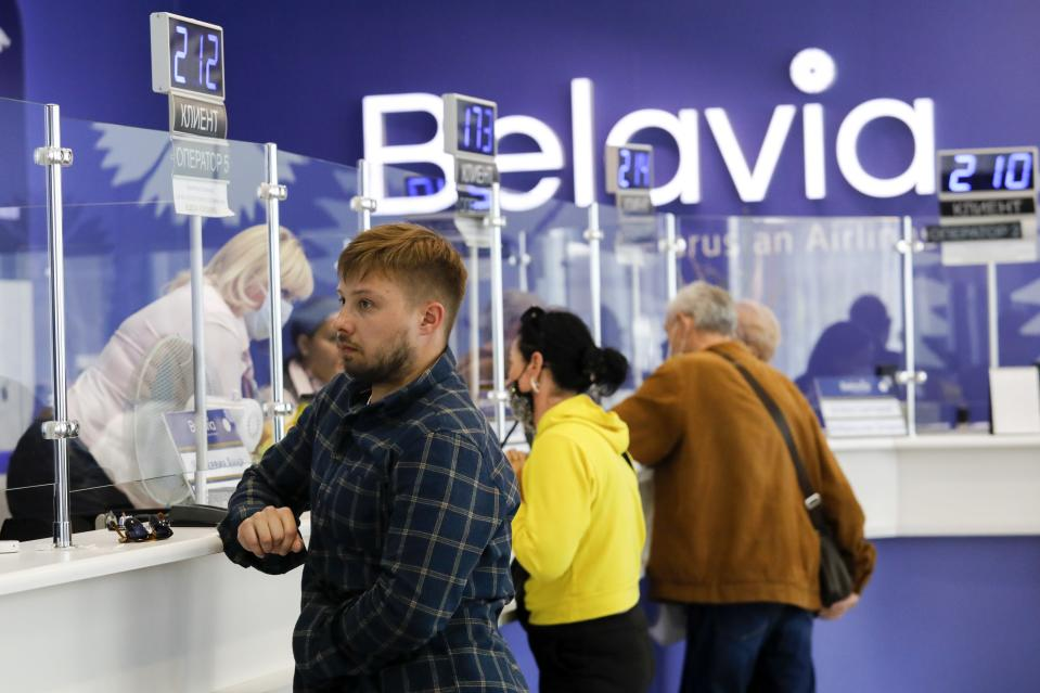 People return their tickets to fly abroad at an office of Belarus' national carrier, Belavia, in Minsk, Belarus, Friday, May 28, 2021. The European Union has banned flights from Belarus after a Ryanair jetliner was diverted to Minsk on Sunday, May 23, 2021, and authorities arrested a dissident journalist who was aboard. Those who want to leave Belarus are finding few options. (AP Photo)