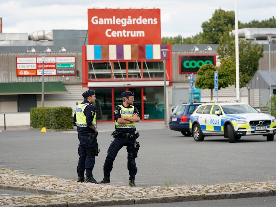 Police monitor the area at the scene of a shooting in Kristianstad (EPA/Johan Nilsson)