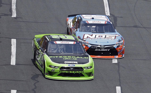 Brad Keselowski (22) battles with Kyle Busch (18) during the NASCAR Xfinity series auto race at Charlotte Motor Speedway in Charlotte, N.C., Saturday, May 26, 2018. (AP Photo/Chuck Burton)