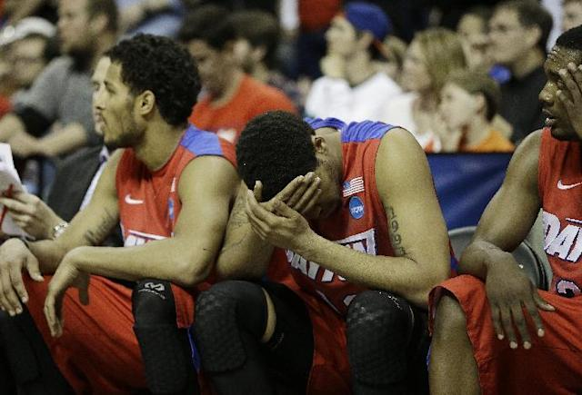 Dayton forward/center Jalen Robinson (12) and other players sit on the bench during the second half in a regional final game against Florida at the NCAA college basketball tournament, Saturday, March 29, 2014, in Memphis, Tenn. Florida won 62-52. (AP Photo/Mark Humphrey)