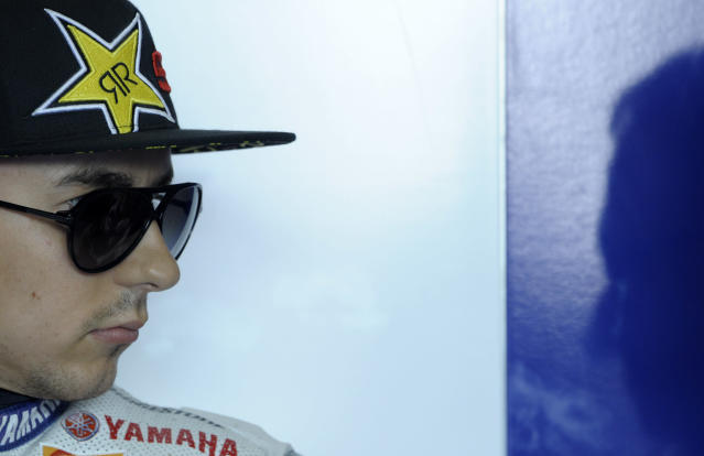 Yamaha Factory Racing team's Spanish rider Jorge Lorenzo listens his mechanic in the pit before the Moto GP free practice 3 of the Portuguese Grand Prix in Estoril, outskirts of Lisbon, on May 5, 2012. AFP PHOTO / MIGUEL RIOPAMIGUEL RIOPA/AFP/GettyImages