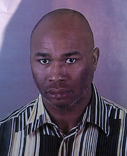 FILE - This undated file photo provided by the Brookfield Police Dept. shows Radcliffe Franklin Haughton, 45, of Brown Deer, Wis. Haughton asked a taxi driver for advice on how to handle his wife on his way to the salon where he shot seven people before killing himself, according to the Brookfield Police Department, which released hundreds of pages of police reports on Friday, March 1, 2013, as well as 911 calls and security video. (AP Photo/Brookfield Police Dept., File)