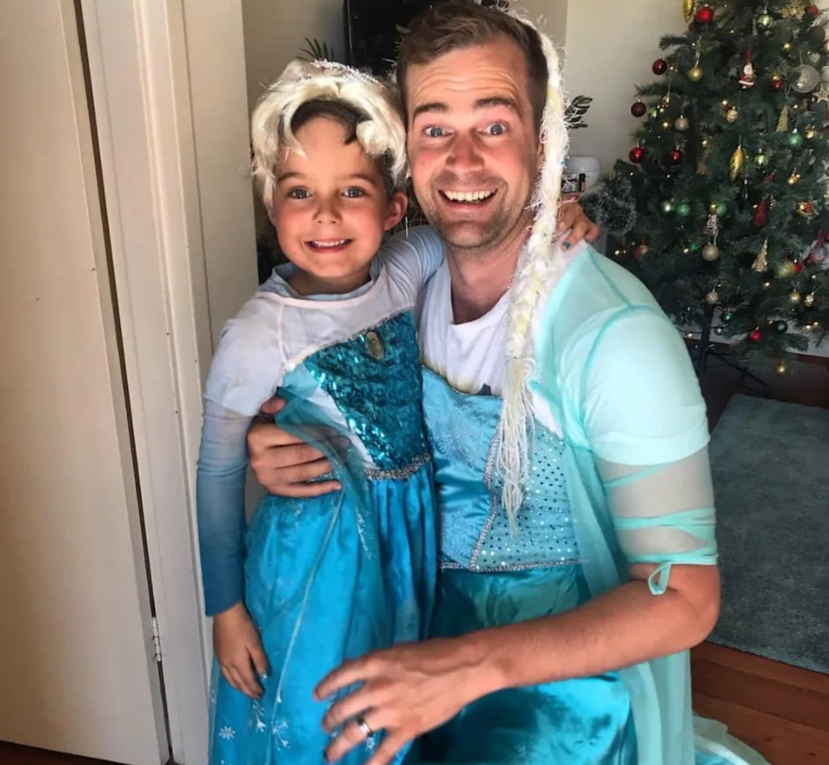 father and son both dressed up in an Elsa dress