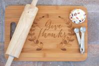 """<p><strong>UrbanFarmhouseTampa</strong></p><p>etsy.com</p><p><strong>$25.00</strong></p><p><a href=""""https://go.redirectingat.com?id=74968X1596630&url=https%3A%2F%2Fwww.etsy.com%2Flisting%2F253980036%2Fgive-thanks-cutting-board-personalized&sref=https%3A%2F%2Fwww.housebeautiful.com%2Fentertaining%2Fholidays-celebrations%2Fg22701307%2Fthanksgiving-gifts%2F"""" rel=""""nofollow noopener"""" target=""""_blank"""" data-ylk=""""slk:BUY NOW"""" class=""""link rapid-noclick-resp"""">BUY NOW</a></p><p>A personalized gift is always a thoughtful idea, and doubly so when it's something useful, like this cutting board.</p>"""