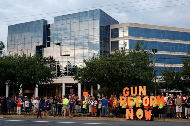 PHOTO: FILE - In this Aug. 5, 2019, file photo, people gather at a vigil for recent victims of gun violence outside the National Rifle Association's headquarters building in Fairfax, Va.  (Patrick Semansky/AP)