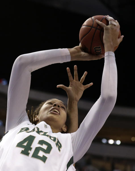 Baylor' Brittney Griner (42)eludes an Oklahoma State defender as she goes up for a score in the first half of an NCAA college basketball game in the Big 12 women's tournament Sunday, March 10, 2013, in Dallas. (AP Photo/Tony Gutierrez)