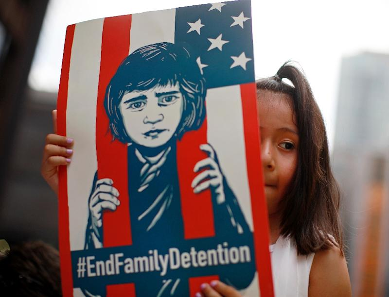 A girl takes part in a protest in Chicago on June 30 against the US separation of migrant families