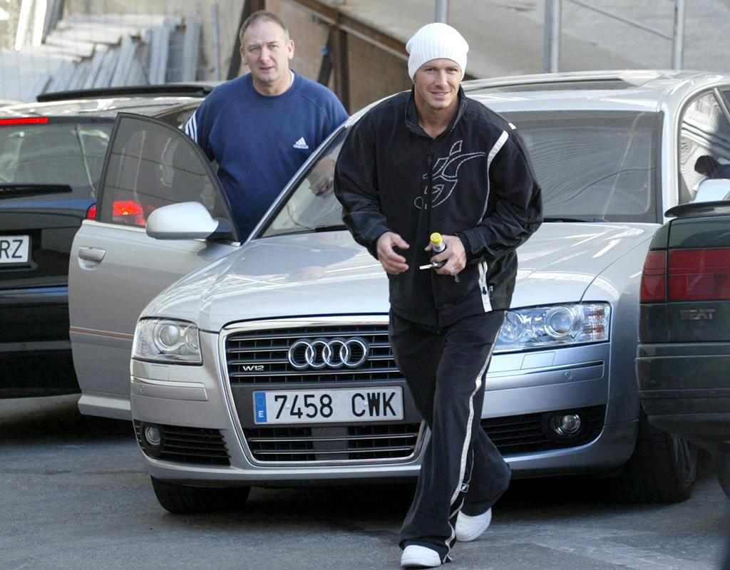 David Beckham arriving at Real Madrid training with his dad Ted Beckham February 2005. Mirrorpix/Courtesy Everett Collection (MPGD6555048)