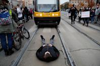 A man lies on tram tracks as people protest against the ruling by Poland's Constitutional Tribunal that imposes a near-total ban on abortion, in Warsaw, Poland October 26, 2020. REUTERS/Kacper Pempel