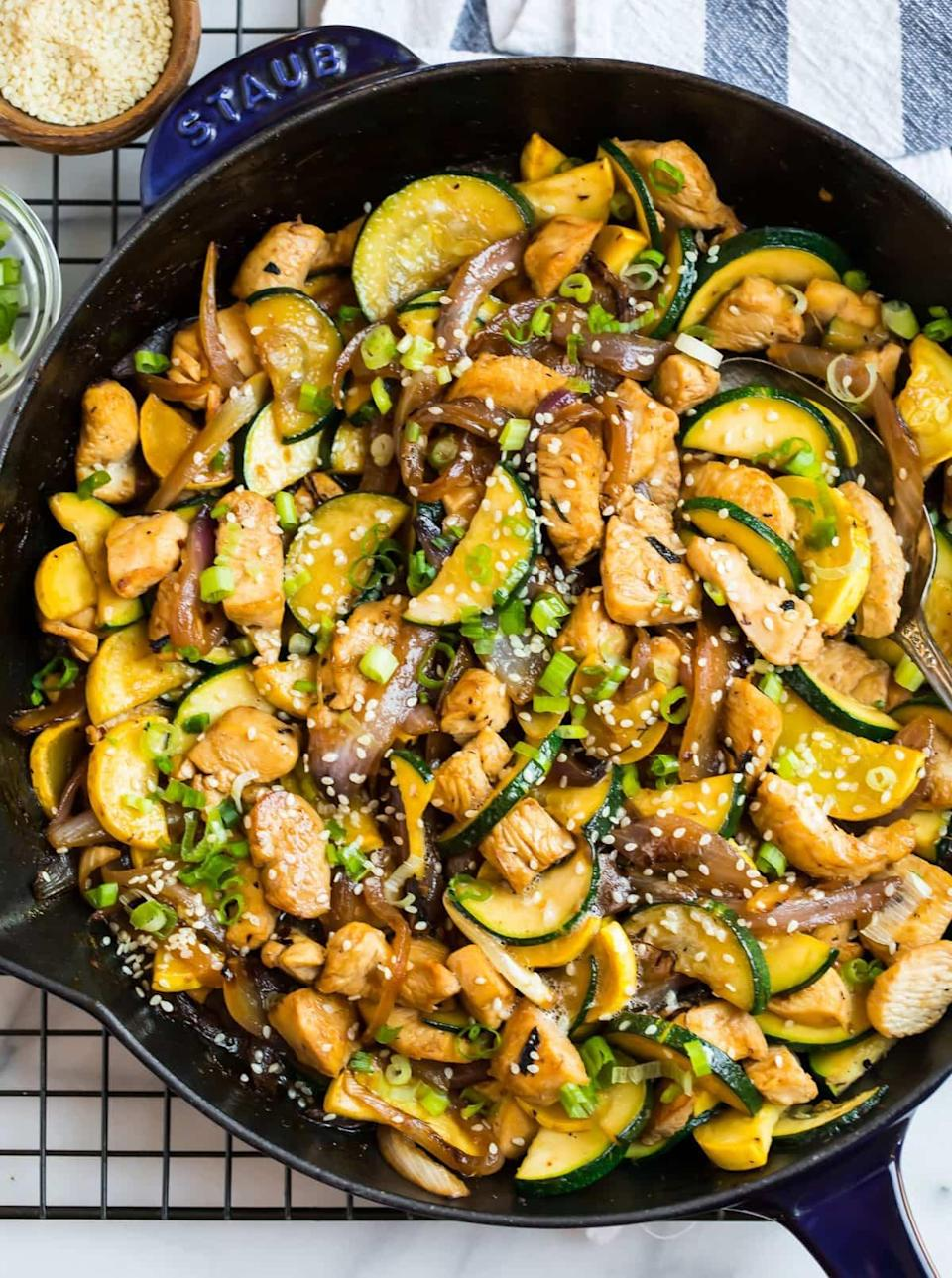 "<p>Shake up the usual stir-fry when you cook up this enticing meal. Made with chicken, zucchini, and onions, it's packed with flavor and topped with a gooey sauce that effortlessly ties all the flavors together.</p> <p><strong>Get the recipe</strong>: <a href=""https://www.wellplated.com/zucchini-stir-fry/"" class=""link rapid-noclick-resp"" rel=""nofollow noopener"" target=""_blank"" data-ylk=""slk:zucchini stir-fry"">zucchini stir-fry</a></p>"