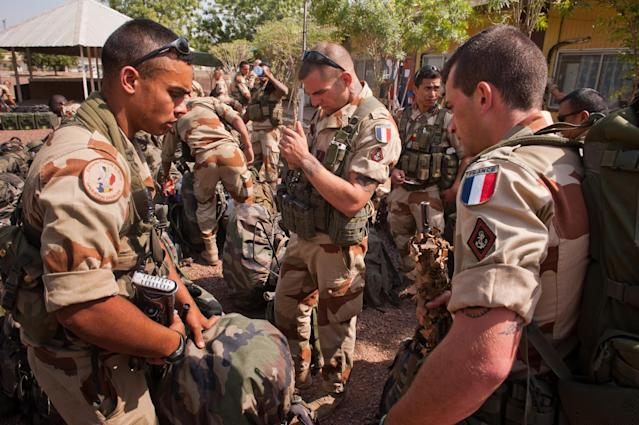This picture released by the French Army Communications Audiovisual office (ECPAD) shows French soldiers getting ready before boarding to Bamako, the capital from Mali, at Kossei camp in N'Djamena, Chad, Friday, Jan. 11, 2013. The battle to retake Mali's north from the al-Qaida-linked groups controlling it began in earnest Saturday, after hundreds of French forces deployed to the country and began aerial bombardments to drive back the Islamic extremists from a town seized earlier this week. (AP Photo/ R.Nicolas-Nelson, Ecpad)