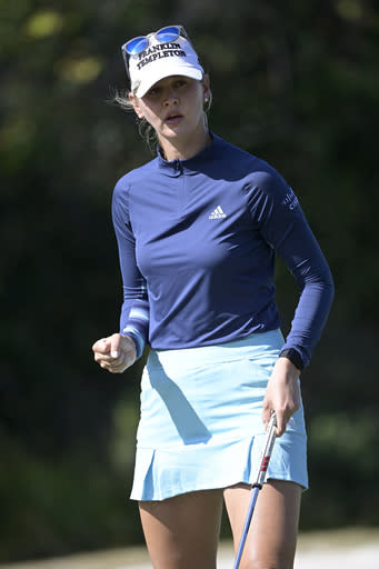 Jessica Korda pumps her fist after making a putt on the sixth green during the final round of the Tournament of Champions LPGA golf tournament, Sunday, Jan. 24, 2021, in Lake Buena Vista, Fla. (AP Photo/Phelan M. Ebenhack)