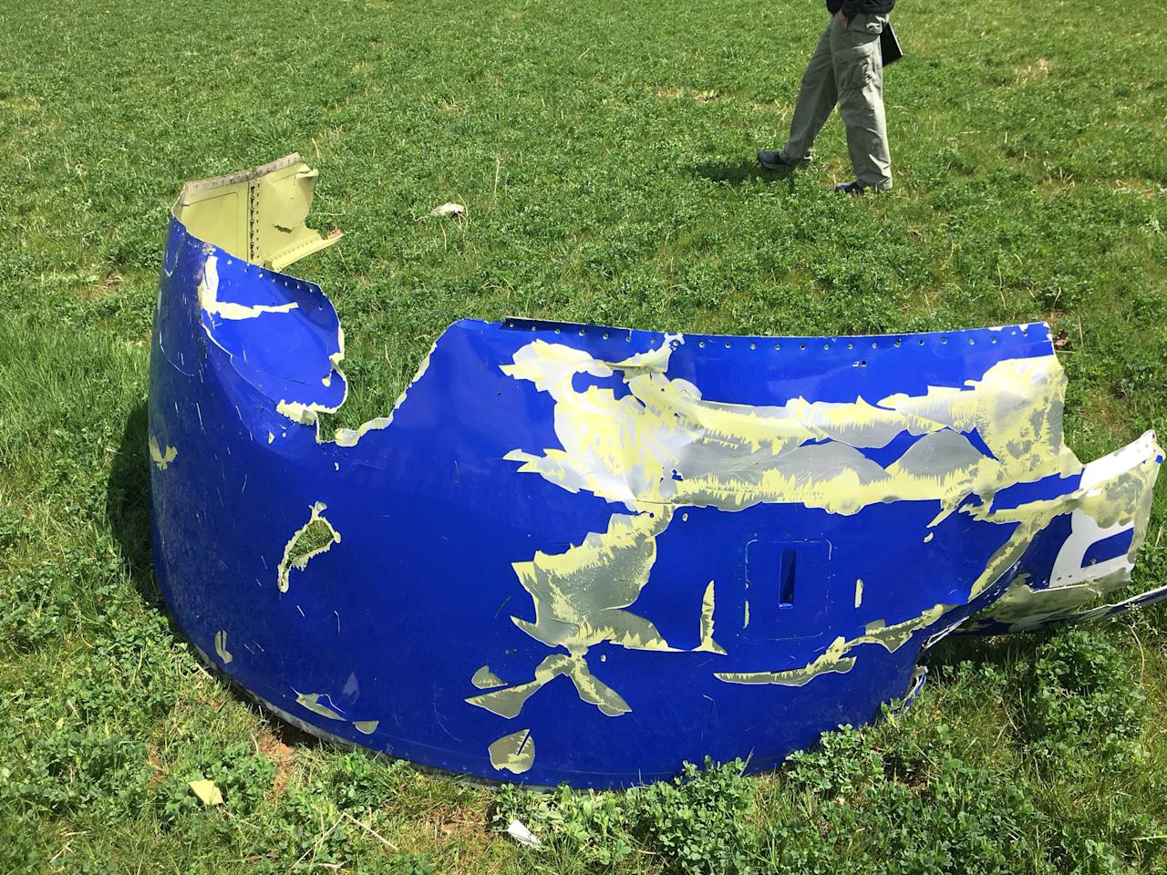 <p>A NTSB photo shows a part of the engine cowling from the Southwest Airlines plane which blew its engine in mid air yesterday over the skies of Philadelphia, Pa., in this image released on April 18, 2018. (Photo: NTSB/Handout via Reuters) </p>