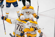 Nashville Predators left wing Austin Watson celebrates a goal against the Colorado Avalanche with teammates P.K. Subban (76) and Colton Sissons (10) during the first period in Game 6 of an NHL hockey first-round playoff series Sunday, April 22, 2018, in Denver. (AP Photo/Jack Dempsey)