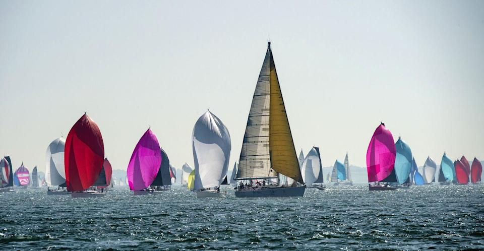 """<p>This small British isle holds the ultimate sailing event - the oldest and largest annual sailing regatta in the World, Cowes Week. And sunny, quaint Cowes, really is the perfect town to host it. </p><p>Soak up the action as the competitive yachtsmen race the five-mile channel between England and the Isle of Wight on up to a thousand beautiful boats, before flocking to the shore alongside weekend enthusiasts and sailing champions to kick back in Cowes' vibrant pubs and bars.</p><p><a class=""""link rapid-noclick-resp"""" href=""""https://www.countrylivingholidays.com/tours/england-coast-cowes-week-cornwall-devon-tradewind-cruise"""" rel=""""nofollow noopener"""" target=""""_blank"""" data-ylk=""""slk:EXPERIENCE COWES WEEK THIS SUMMER"""">EXPERIENCE COWES WEEK THIS SUMMER</a></p>"""