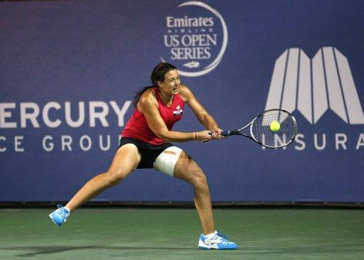 Injured Marion Bartoli (pictured) will need to recover fitness when she plays American Christina McHale next