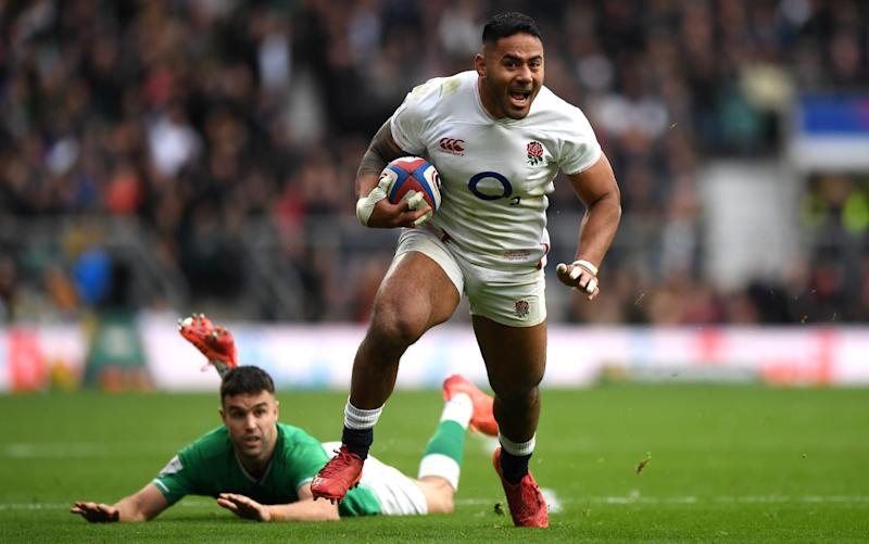 Manu Tuilagi playing for England against Ireland in the Six Nations - GETTY IMAGES