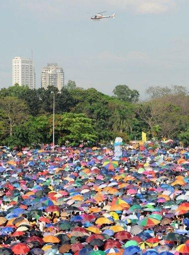 A helicopter hovers above a sea of umbrellas as Iglesia ni Cristo (Church of Christ) members gather at the Quirino grandstand for a rally in Manila. About a million members of the influential sect held rallies in the Philippines, police said, in a show of force amid perceived political tension with once staunch ally President Benigno Aquino