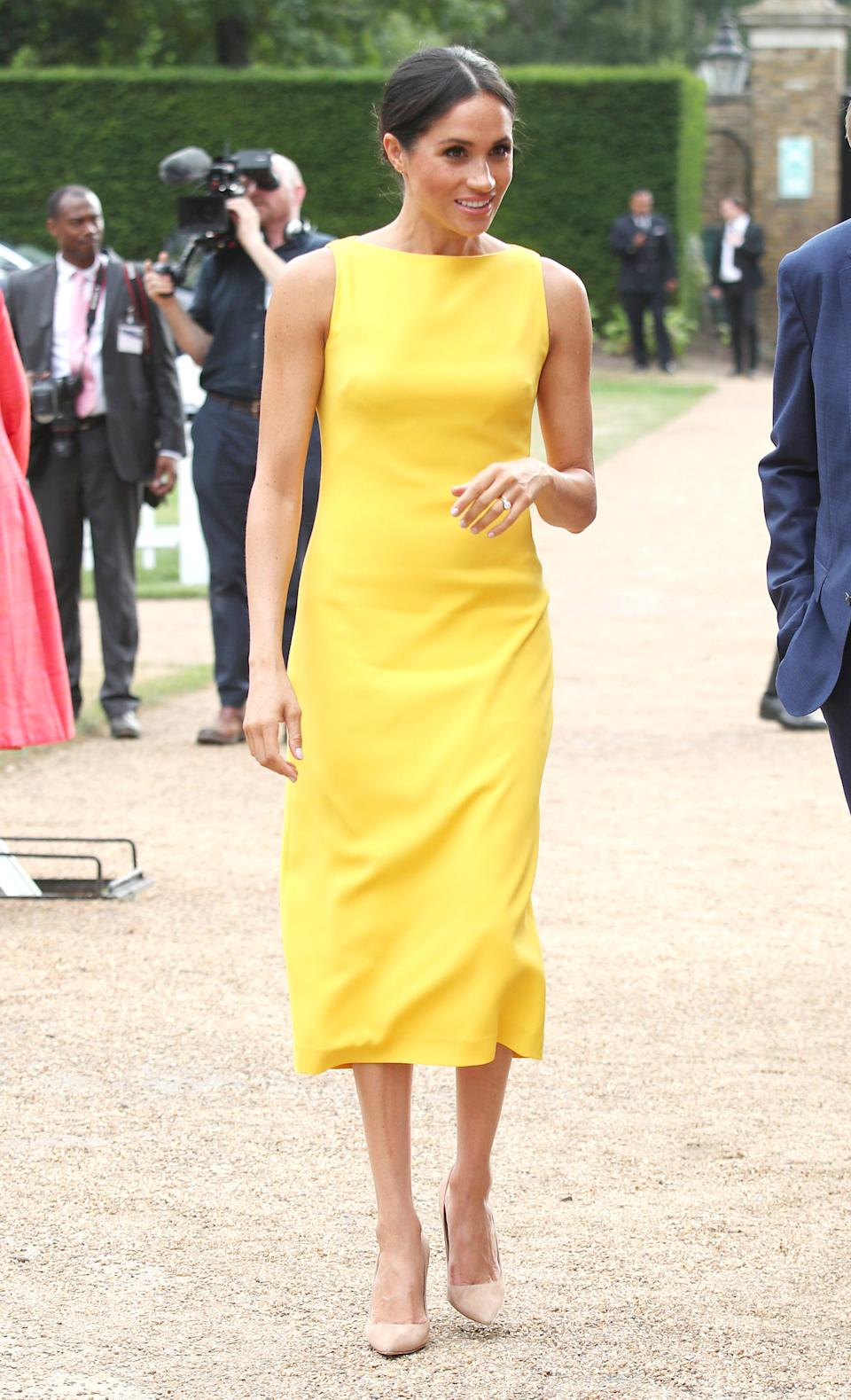 Again one of our favourite looks to date, the Duchess of Sussex chose a punchy £1,300 Brandon Maxwell dress for the Commonwealth meeting - a not-so-subtle nod to her American roots. <em>[Photo: Getty]</em>