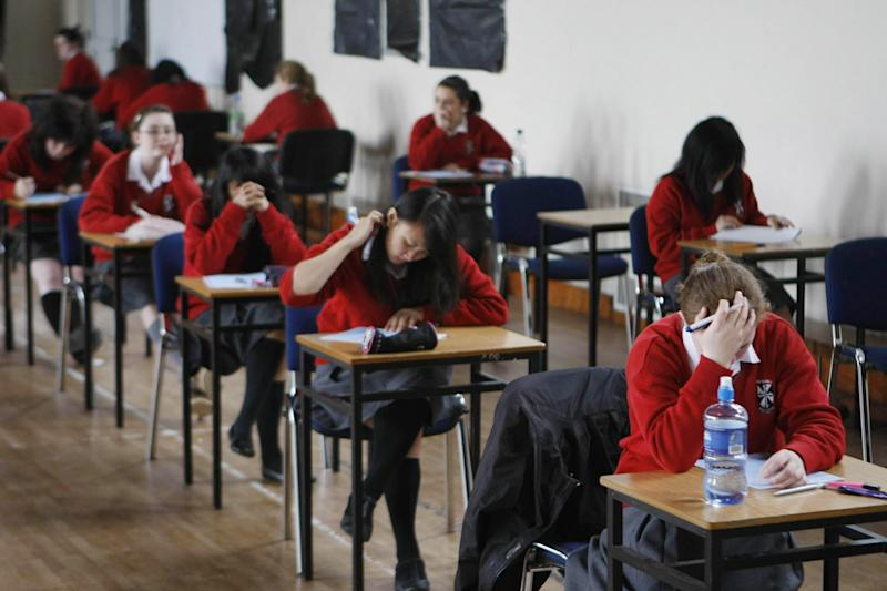 Cost-cutting: Pupils at a north London school were forced to wear coats and hats in class: PA