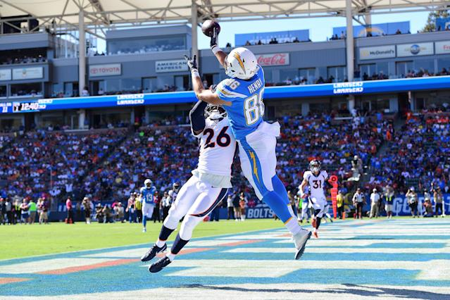 <p>Darian Stewart #26 of the Denver Broncos interferes with the pass from Hunter Henry #86 of the Los Angeles Chargers during the first quarter at the StubHub Center on October 22, 2017 in Carson, California. (Photo by Harry How/Getty Images) </p>