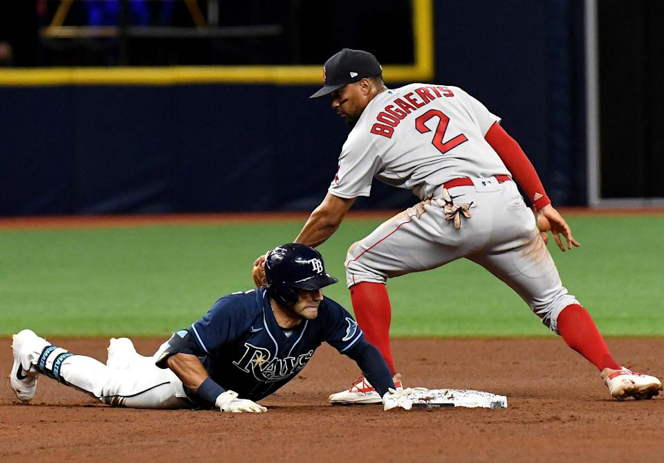 Kevin Kiermaier dives back to second base with Xander Bogaerts there during an August game at Tropicana Field.
