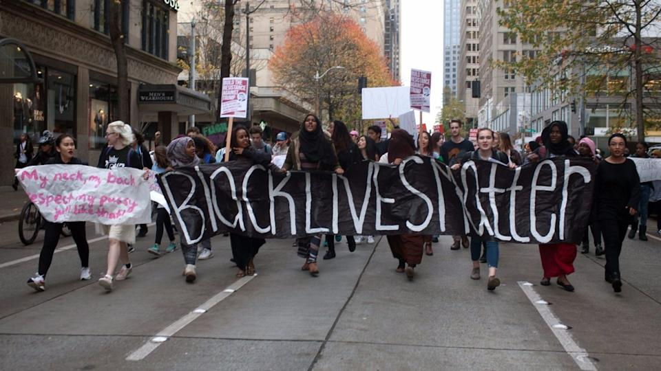 Protesters march through downtown Seattle.
