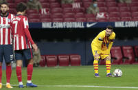 Barcelona's Lionel Messi prepares to take a free-kick during the Spanish La Liga soccer match between Atletico Madrid and FC Barcelona at the Wanda Metropolitano stadium in Madrid, Spain, Saturday, Nov. 21, 2020. (AP Photo/Bernat Armangue)