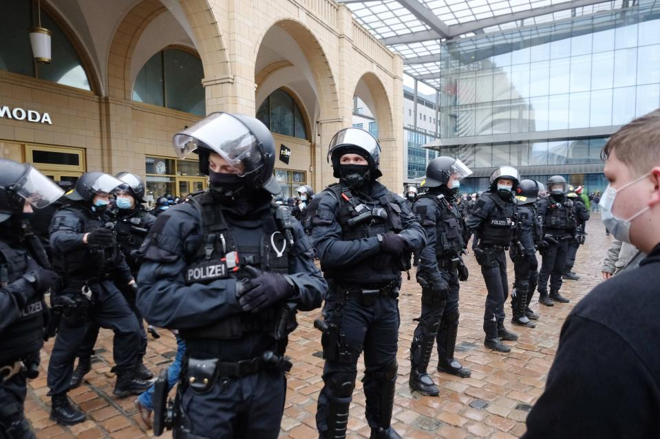 Police officers block the Neumarkt in Chemnitz, Germany, Saturday, March 27, 2021. There participants of a rally wanted to demonstrate against the Corona policy. The meetings were forbidden. (Sebastian Willnow/dpa via AP)