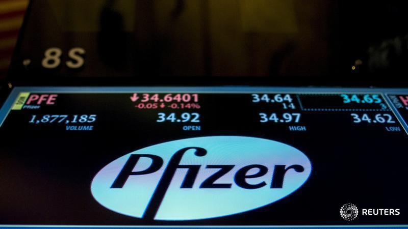 The ticker information for Pfizer is displayed on a screen above the post where it's traded on the floor of the New York Stock Exchange