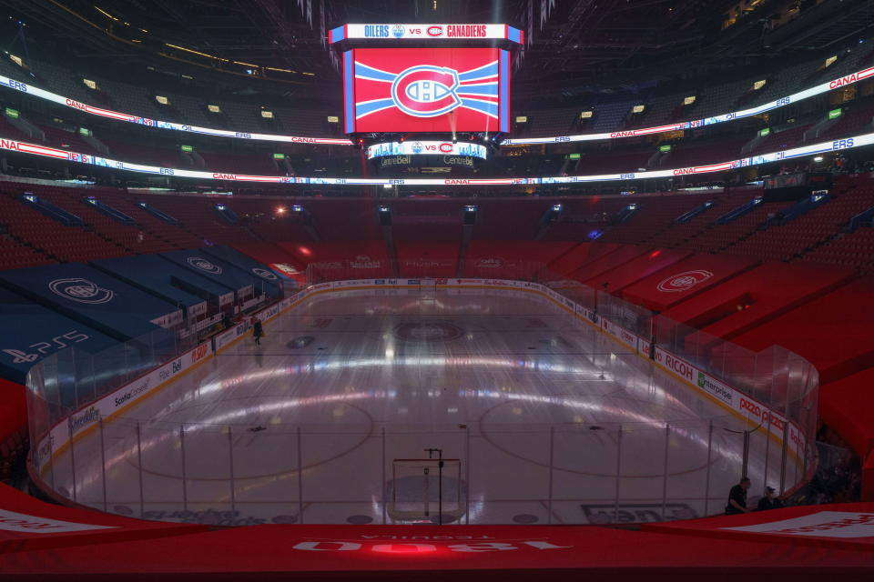 FILE - The clock at the Bell Centre shows graphics before the postponement of an NHL hockey game between the Montreal Canadiens and the Edmonton Oilers in Montreal, in this Monday, March 22, 2021, file photo. The iconic shrine where the Canadiens hoisted 12 of their 24 Cups has been turned into a multiplex theater. The Canadiens have since moved to the Bell Centre, which hosting its first Cup Final series. (Paul Chiasson/The Canadian Press via AP, File)