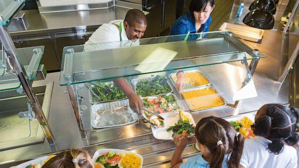PHOTO: Cafeteria workers serving food to school children. (Stock photo/Getty Images)