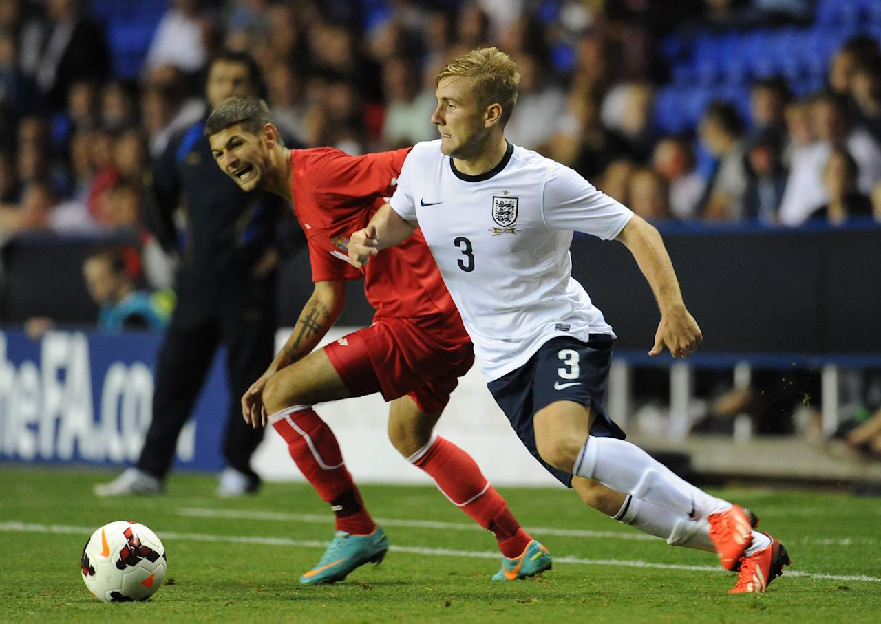 England's Luke Shaw (right) and Moldova's Iurie Mirza (left) battle for the ball during the UEFA Euro Under 21's Qualifying match at The Madejski Stadium, Reading.