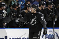 Tampa Bay Lightning defenseman Ryan McDonagh (27) celebrates with the bench after his goal against the Ottawa Senators during the first period of an NHL hockey game Saturday, March 2, 2019, in Tampa, Fla. (AP Photo/Chris O'Meara)